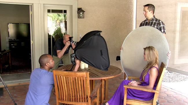 A portrait setup with a speedlight in a softbox, with a reflector.